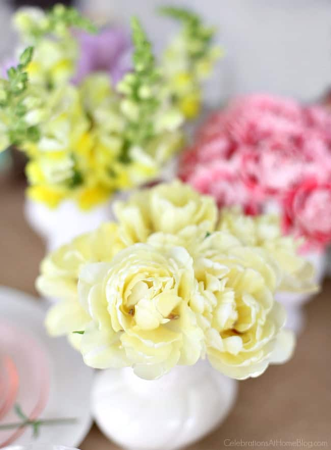 Set a beautiful Easter tablescape with small flowers in mini vases
