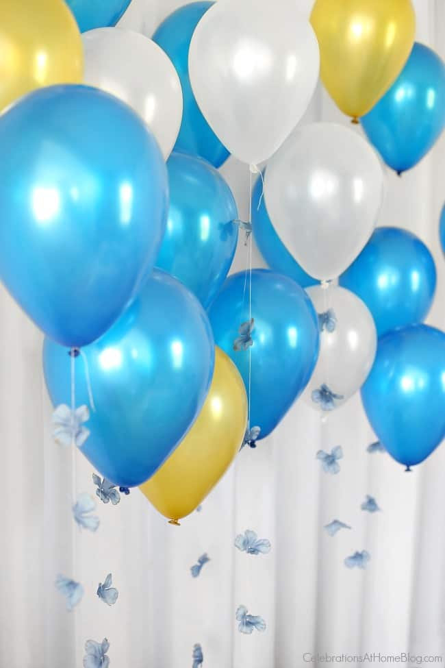 Balloons always make a bridal shower festive! These have diy flower 'tails' to coordinate with the blue bridal brunch.
