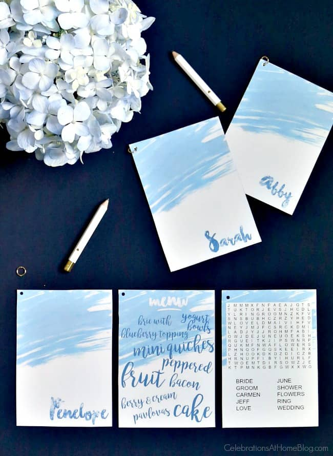 Blue and white place card trio with menu and word search game card; this is perfect for a blue bridal brunch bridal shower