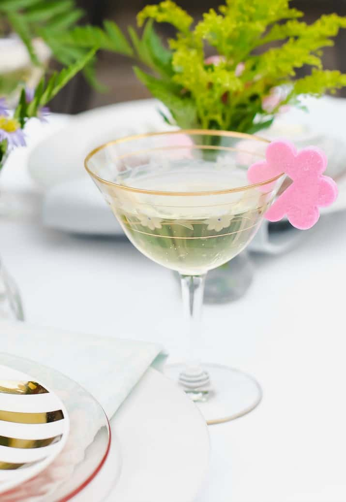 champagne coupe with sugar flower on the rim