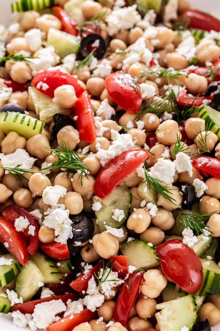 close up of salad of chickpeas, tomatoes, cucumber and feta