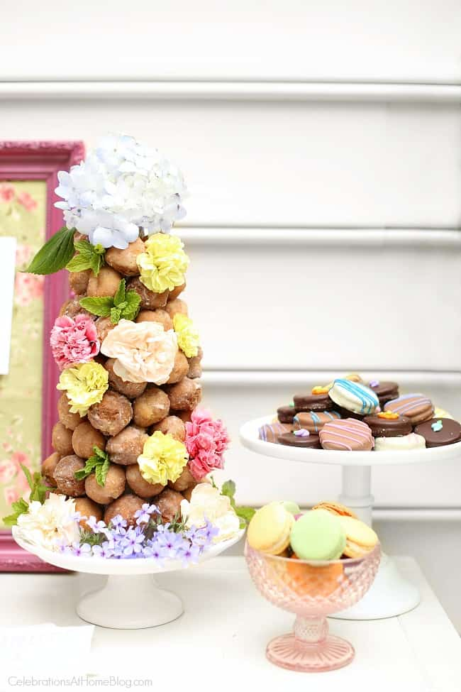 Create a donut tower with flower decorations, for mothers day or ladies luncheon.
