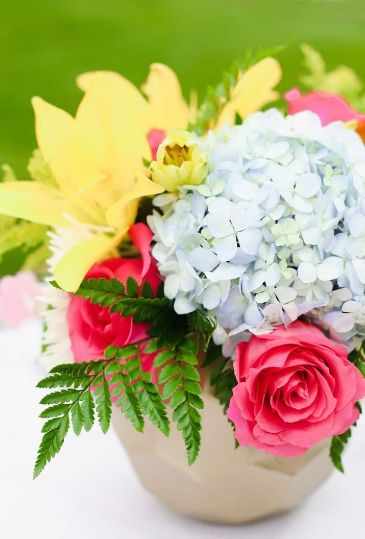 spring flowers in gold vase