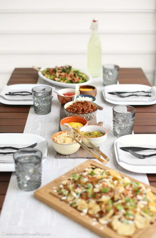 Plan a hot dog roast for summer entertaining with these tips; create a casual table setting with newsprint runner and hot dog toppings.