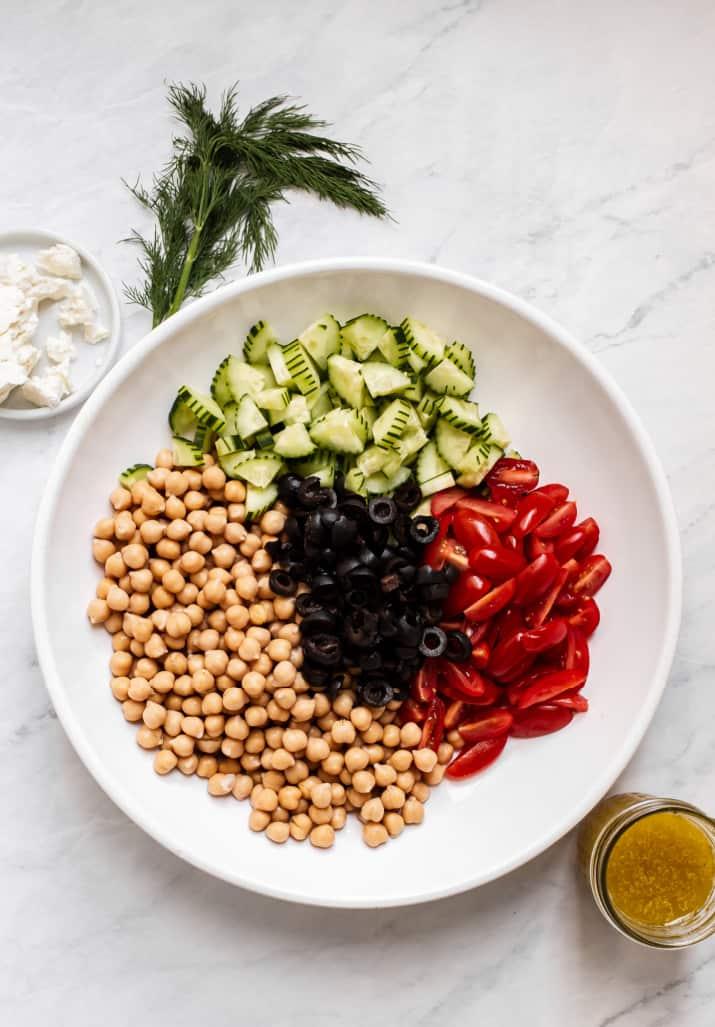 ingredients for Mediterranean chickpea salad in white bowl