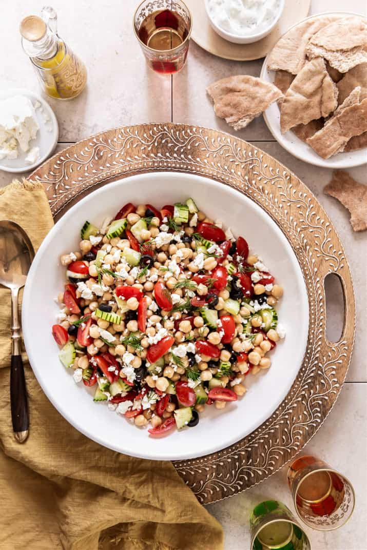 chickpea salad in white serving bowl on party table
