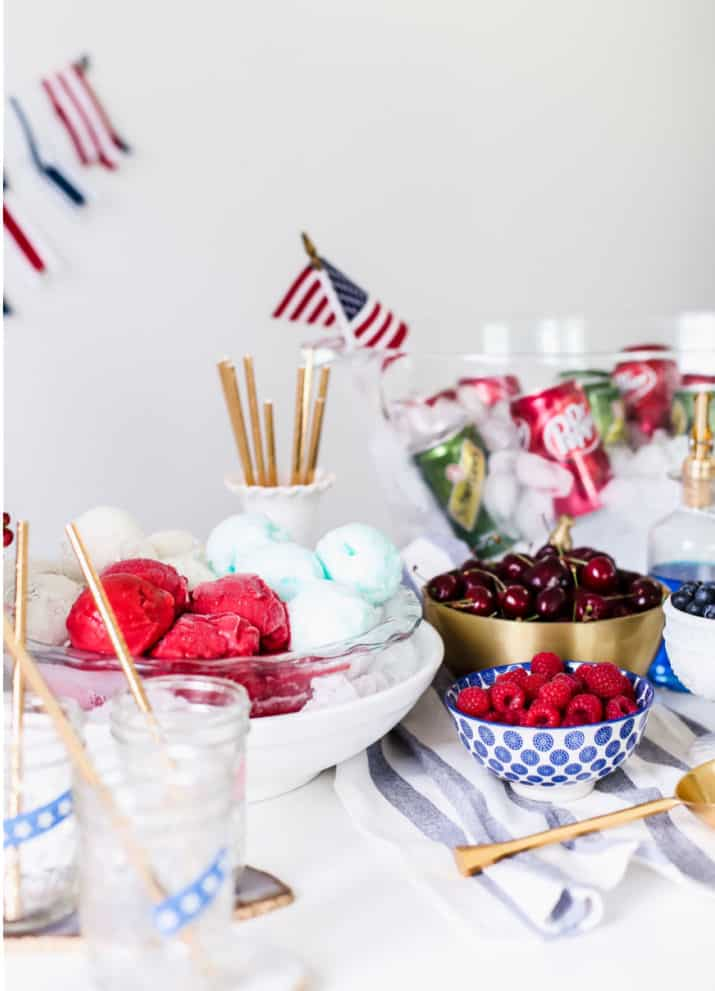 red, white, and blue ice cream bar with berries in bowls