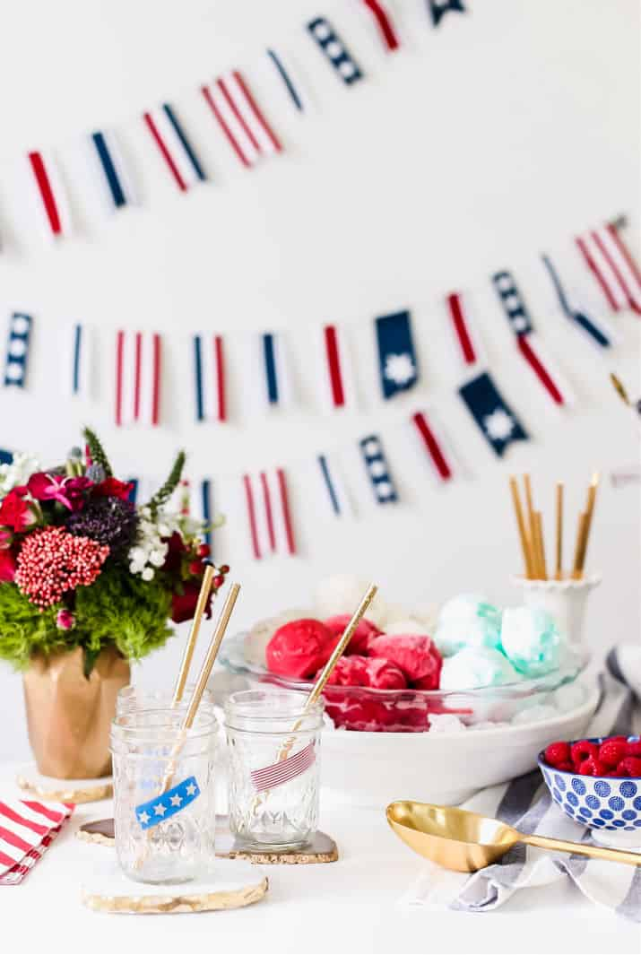 white table with 4th of July decorations and ice cream in bowl