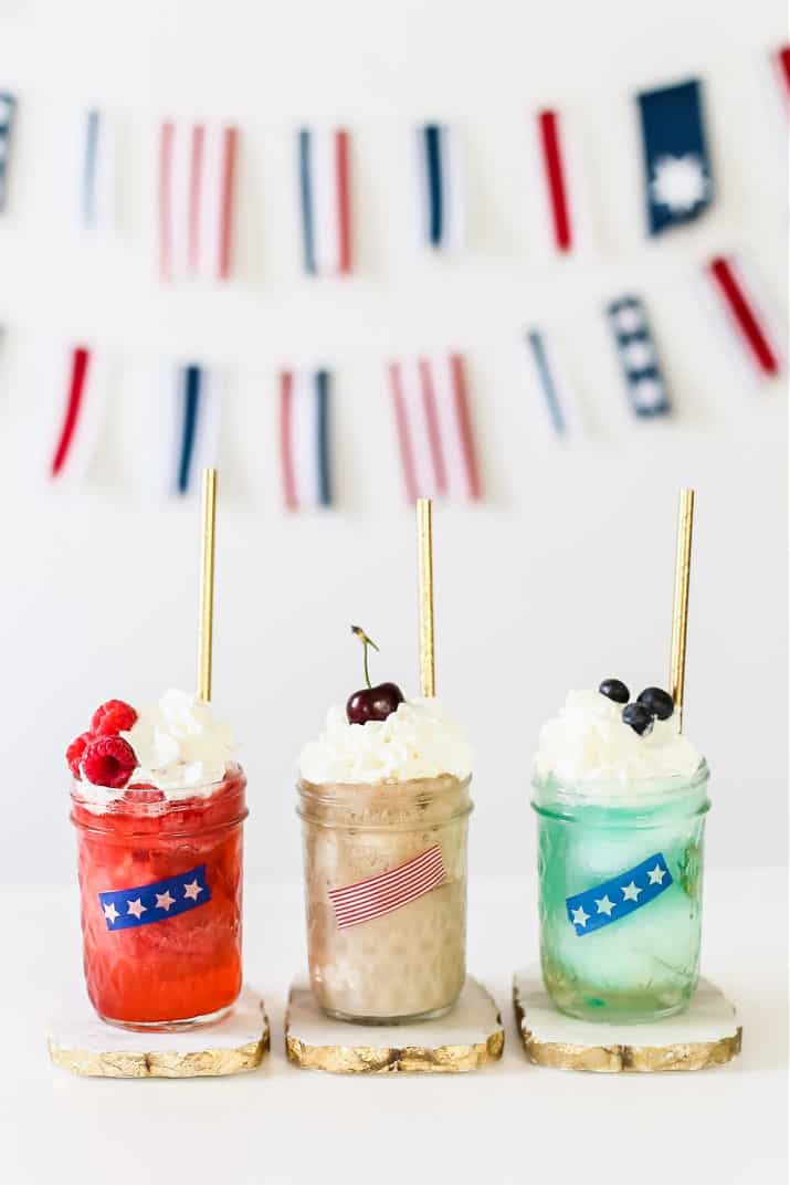red, tan, and blue ice cream floats on white table