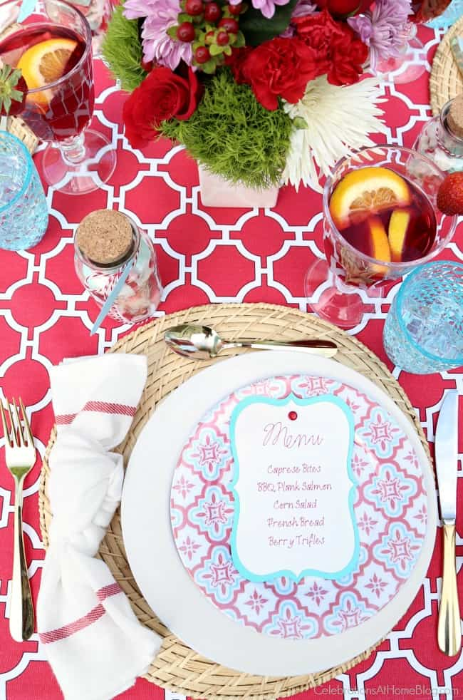 A modern summer dinner party tablescape to inspire your next soiree. Red and white place setting.