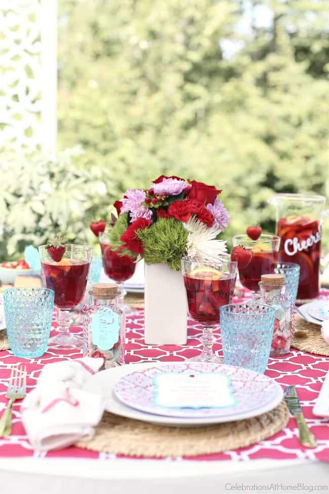 Get inspired with this bright summer dinner party tablescape and host a fun soiree. Red and blue tablescape design.