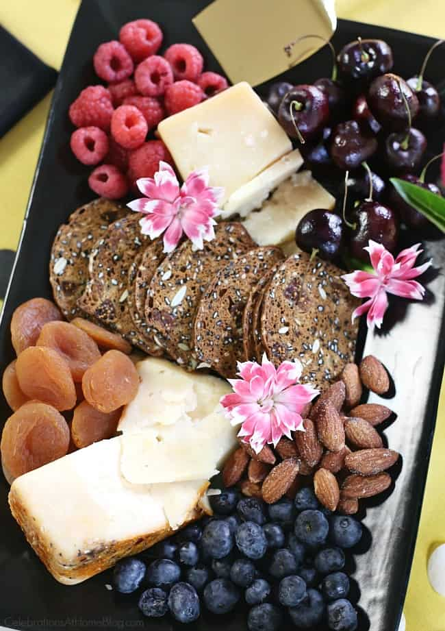 Add a cheese plate for any simple celebration at home! A cheese plate is always a good idea when entertaining at home.