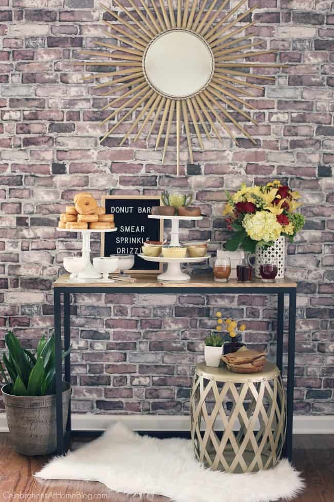 Set up a Donut Bar with Toppings for your next party or shower. This dessert buffet is a treat for everyone. Great bridal shower idea or baby shower idea. This is also a great brunch idea.