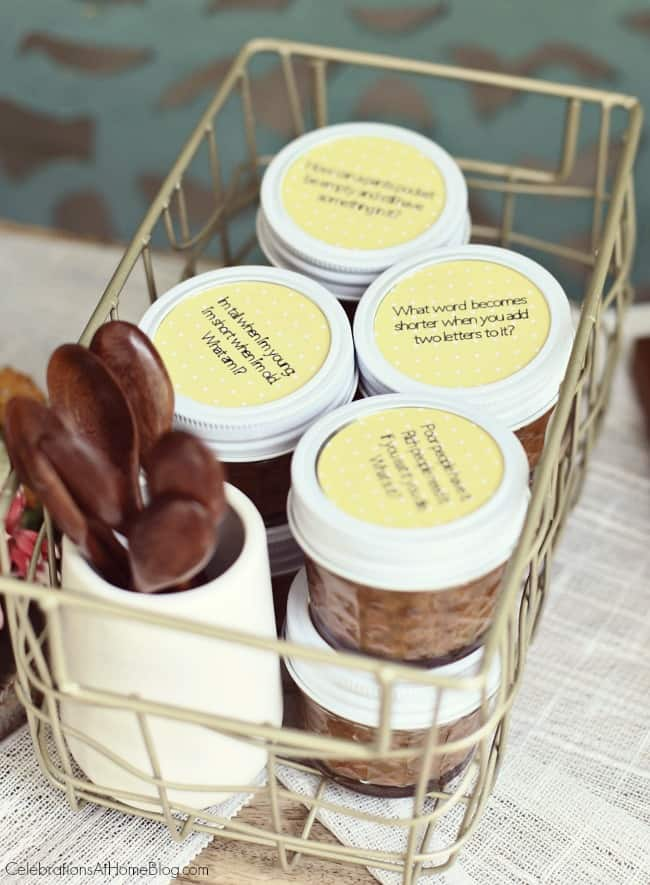Host a Summer Cocktail Party with these ideas. Print brain teasers on paper to place on mini jar lids for a fun guest activity.