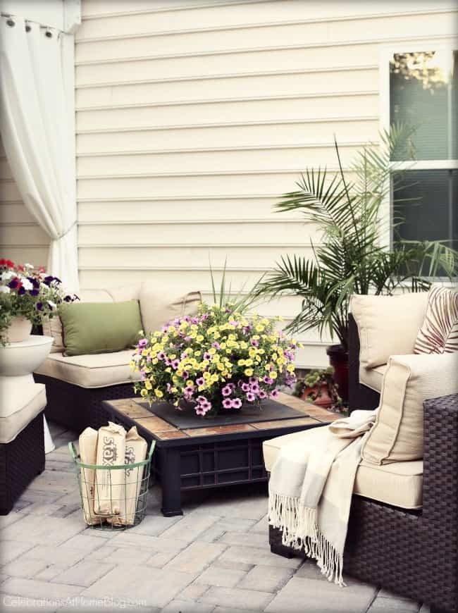 Host a sunset supper party and set up a patio lounge area.