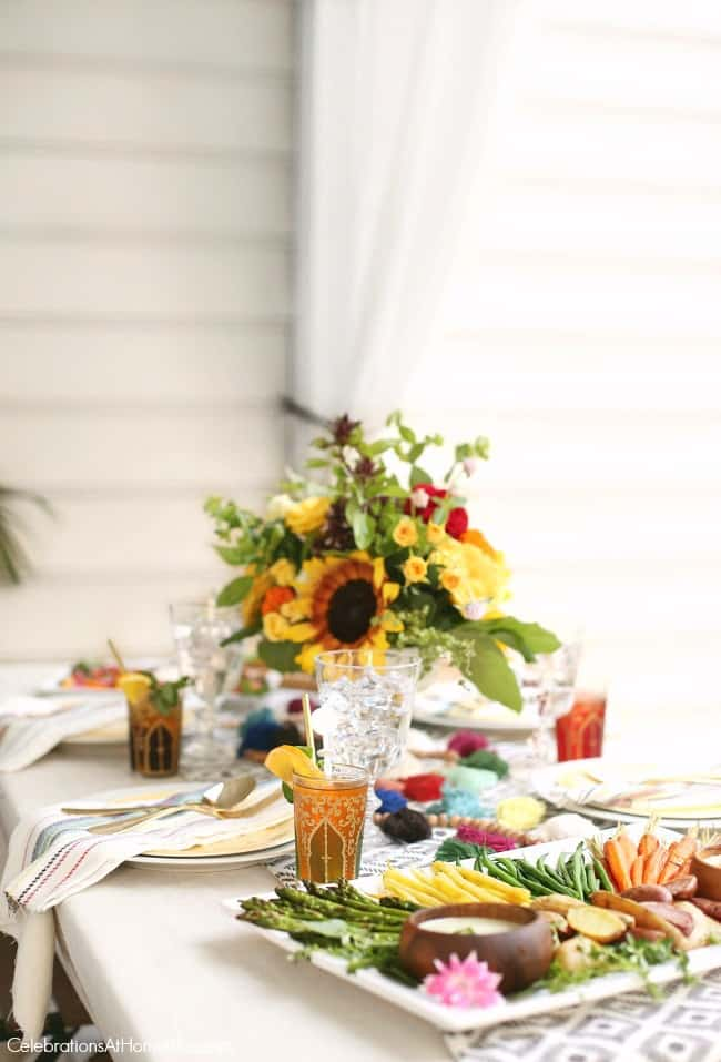 You're going to love this late summer dinner Party with Iced Tea Bar. This party has cool, relaxed vibes with a casual menu and interactive beverage bar. Boho-chic tablescape.