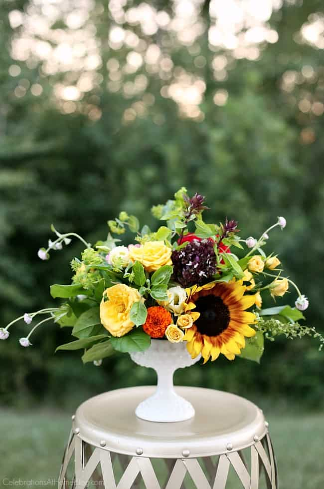 You're going to love this late summer dinner Party with Iced Tea Bar. This party has cool, relaxed vibes with a casual menu and interactive beverage bar. Late summer flower arrangement.