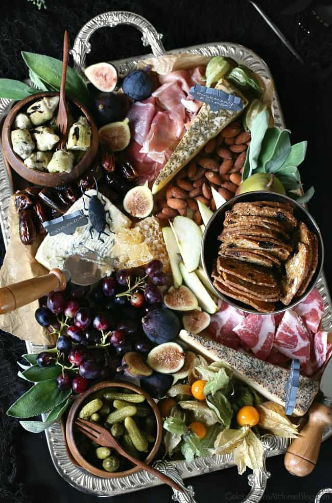 Host a Halloween Themed Dinner Party in Black to celebrate the holiday in a more adult way. Create a fall themed or Halloween themed cheese board.