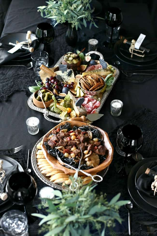 host a halloween themed dinner party in black to celebrate the holiday in a more adult