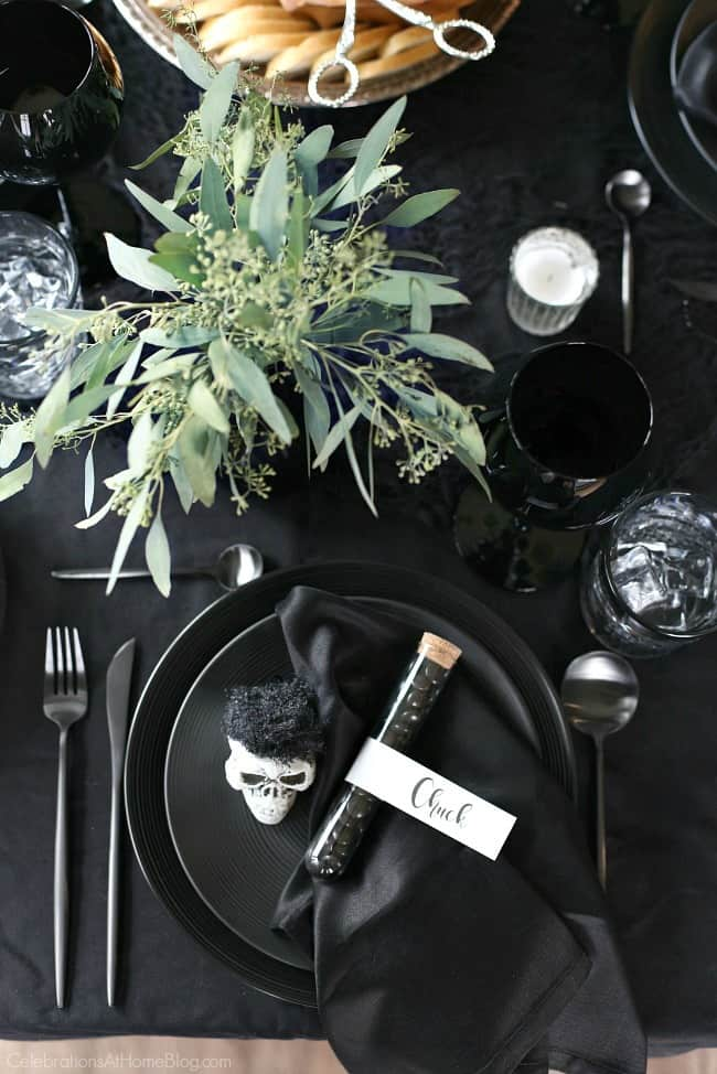Host a Halloween Themed Dinner Party in Black to celebrate the holiday in a more adult way. Set a tablescape that's a balance between creepy and sophisticated with these ideas. Use mini skulls at each place setting.