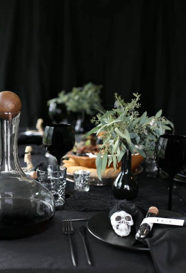 Host a Halloween Themed Dinner Party in Black to celebrate the holiday in a more adult way. Set a tablescape that's a balance between creepy and sophisticated with these ideas.