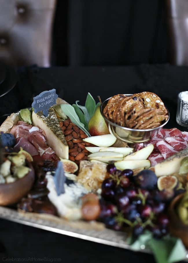 Host a Halloween Themed Dinner Party in Black to celebrate the holiday in a more adult way. Cheese and Charcuterie board.