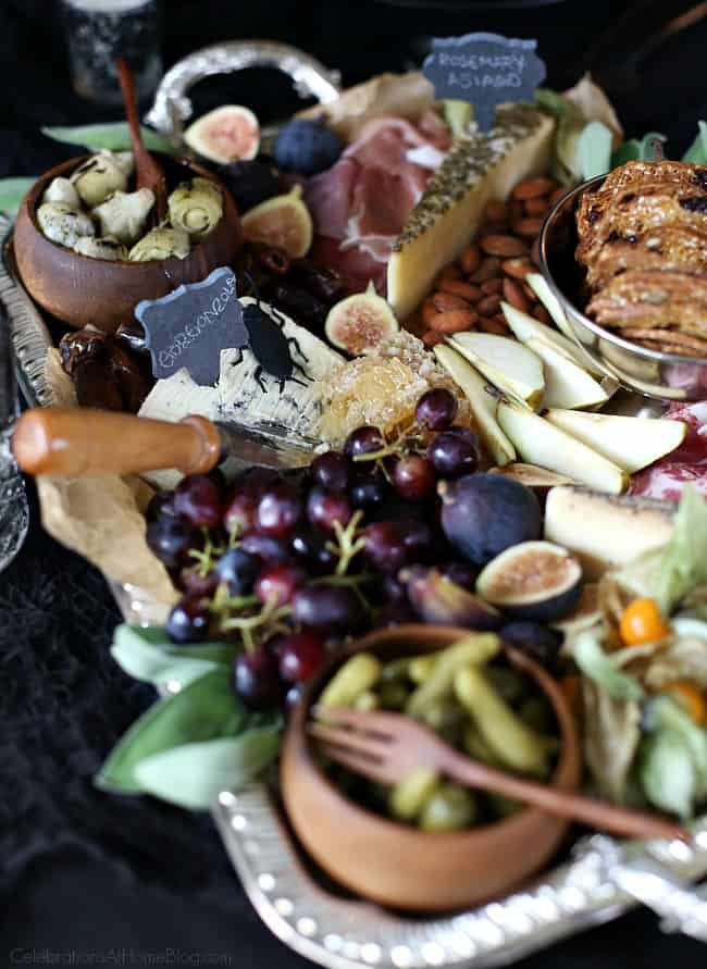 Host a Halloween Themed Dinner Party in Black to celebrate the holiday in a more adult way. Cheese and charcuterie board for Halloween.