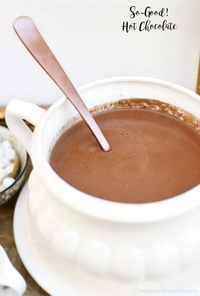 This Homemade Hot Chocolate Recipe is rich and creamy, and tastes like pudding! It's dessert in a cup! Enjoy it all season long while entertaining at home for the holidays and beyond