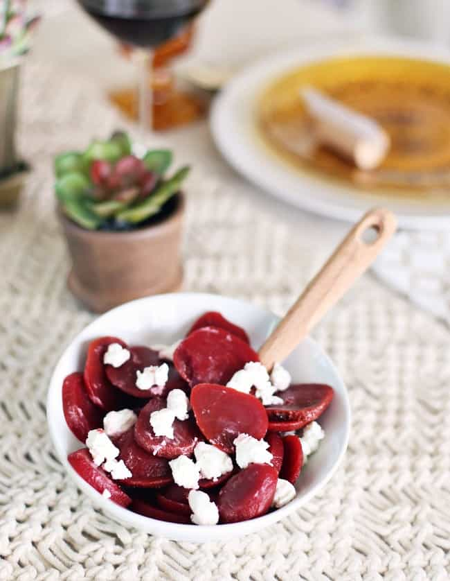 beets and goat cheese in small white dish