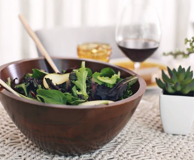 salad in wooden bowl on table