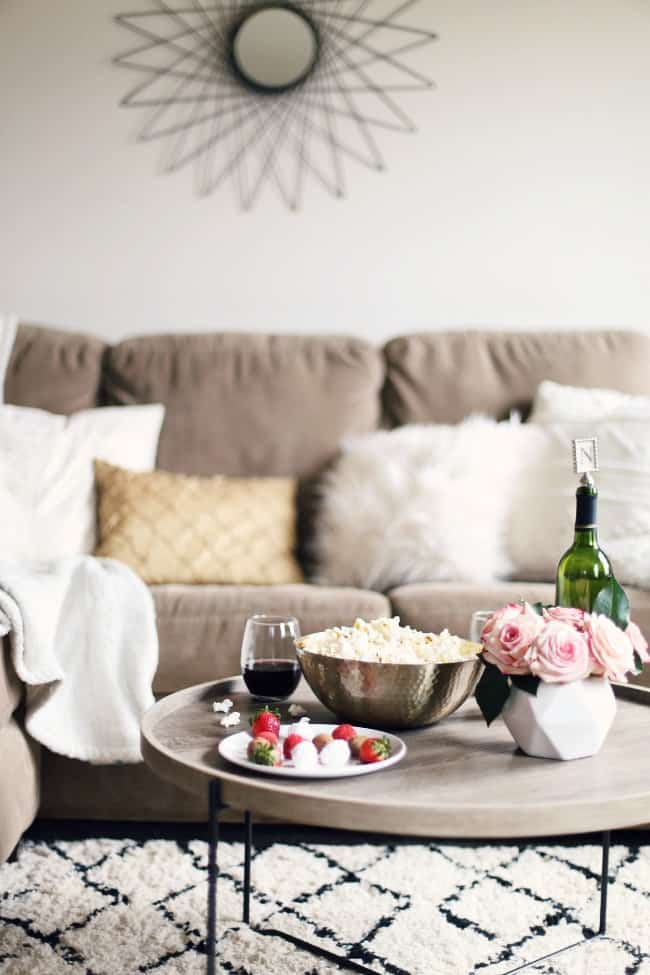favorite romance movies for date night or girls night in, sofa with cocktail table of snacks