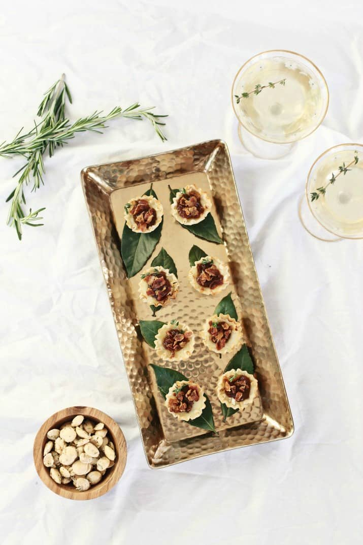 brie party appetizers on gold tray