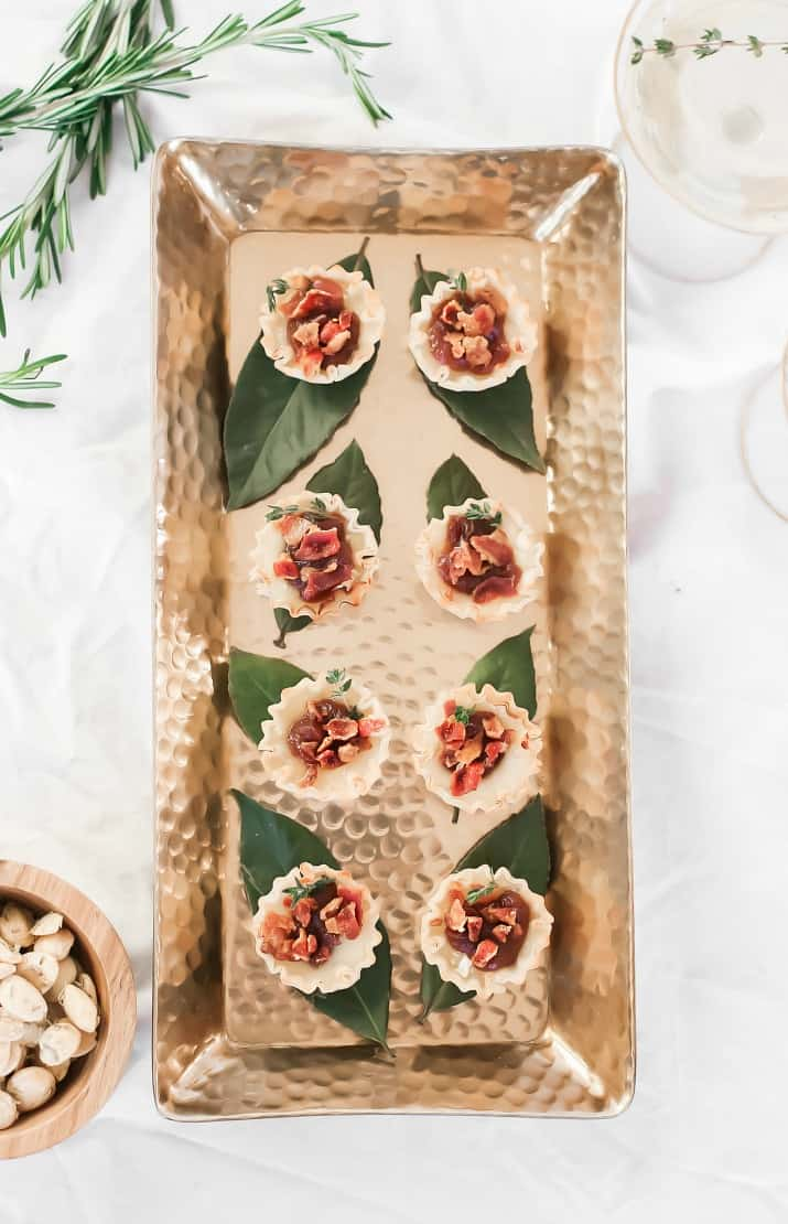 brie cups with bacon and apple butter on gold tray