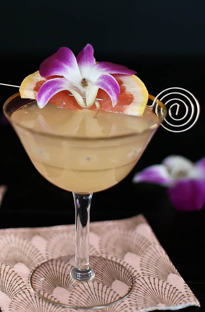 Grapefruit Rosemary Gin Fizz Cocktail with flower garnish