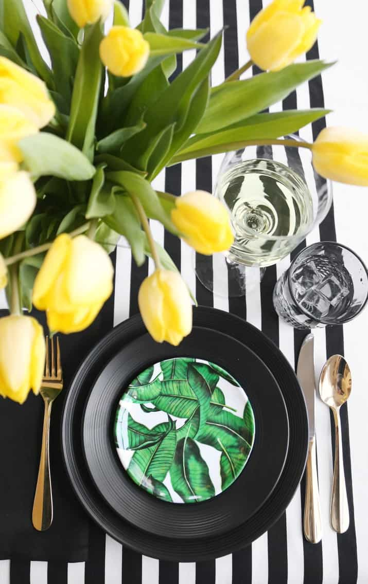 tropical plate on black and white stripes