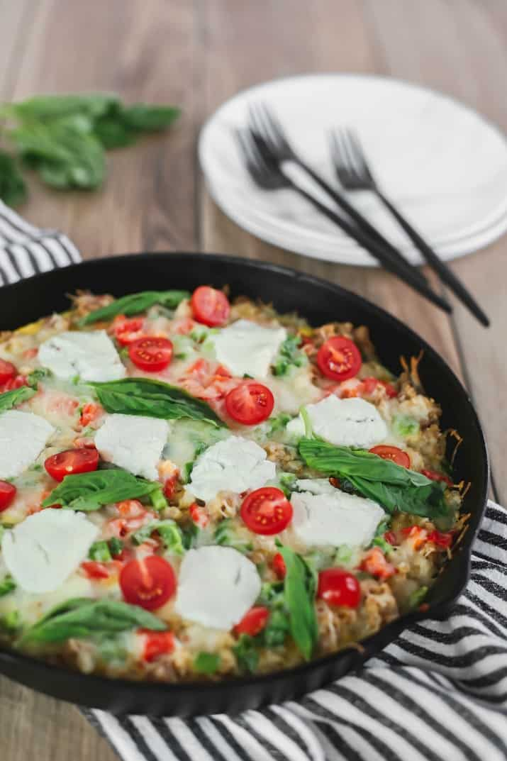 Brunch Skillet Recipe with Sausage & Hash Browns in cast iron skillet with plates