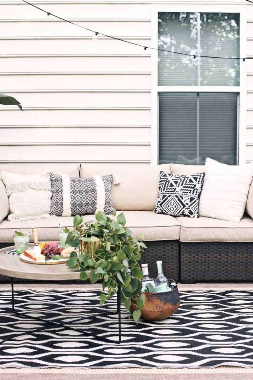 black & tan patio decor, sofa and pillows