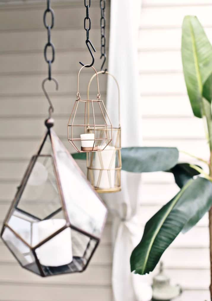 black & tan patio decor with hanging lanterns