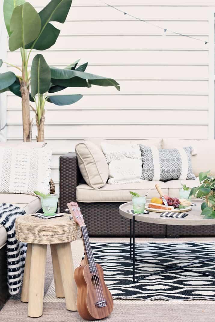 black & tan patio decor with greenery