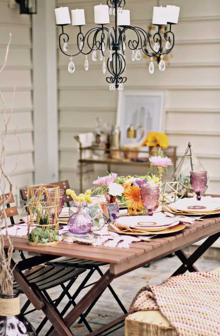 fall tabletop design - dinner party tablescape on patio with chandelier above