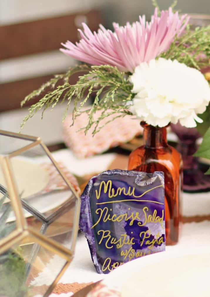 fall tabletop design, fall entertaining dinner party menu written on purple rock