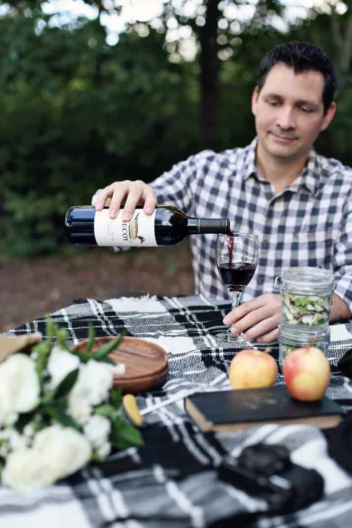 fall picnic, male pouring wine