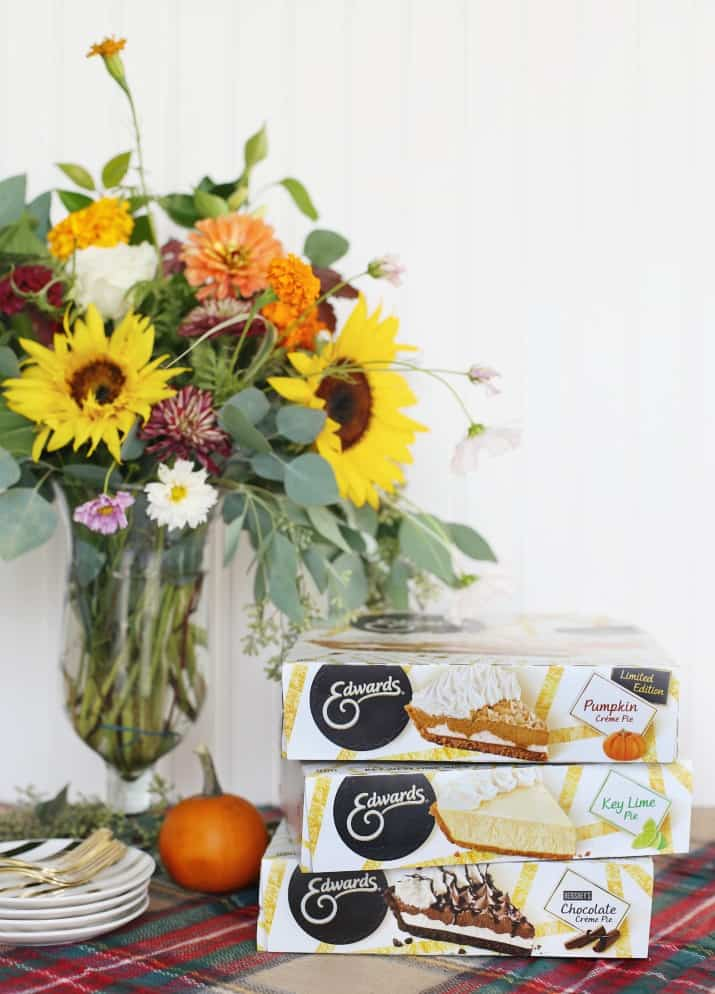 stylish pie bar for holiday entertaining, stack of Edwards pie boxes with flowers