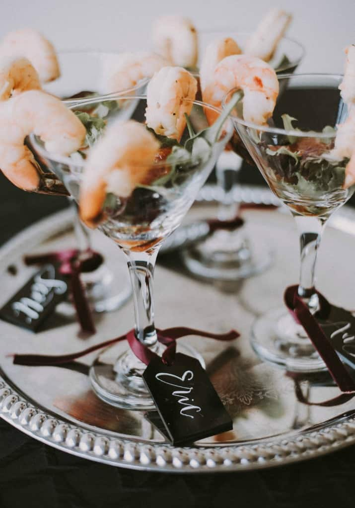 Elegant Beetlejuice Inspired Event Design, shrimp cocktail with name tags attached