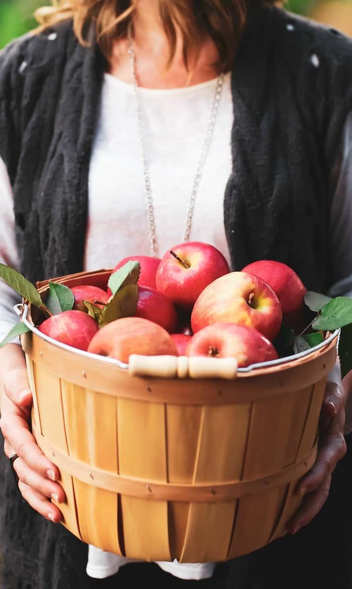 holding basket of apples