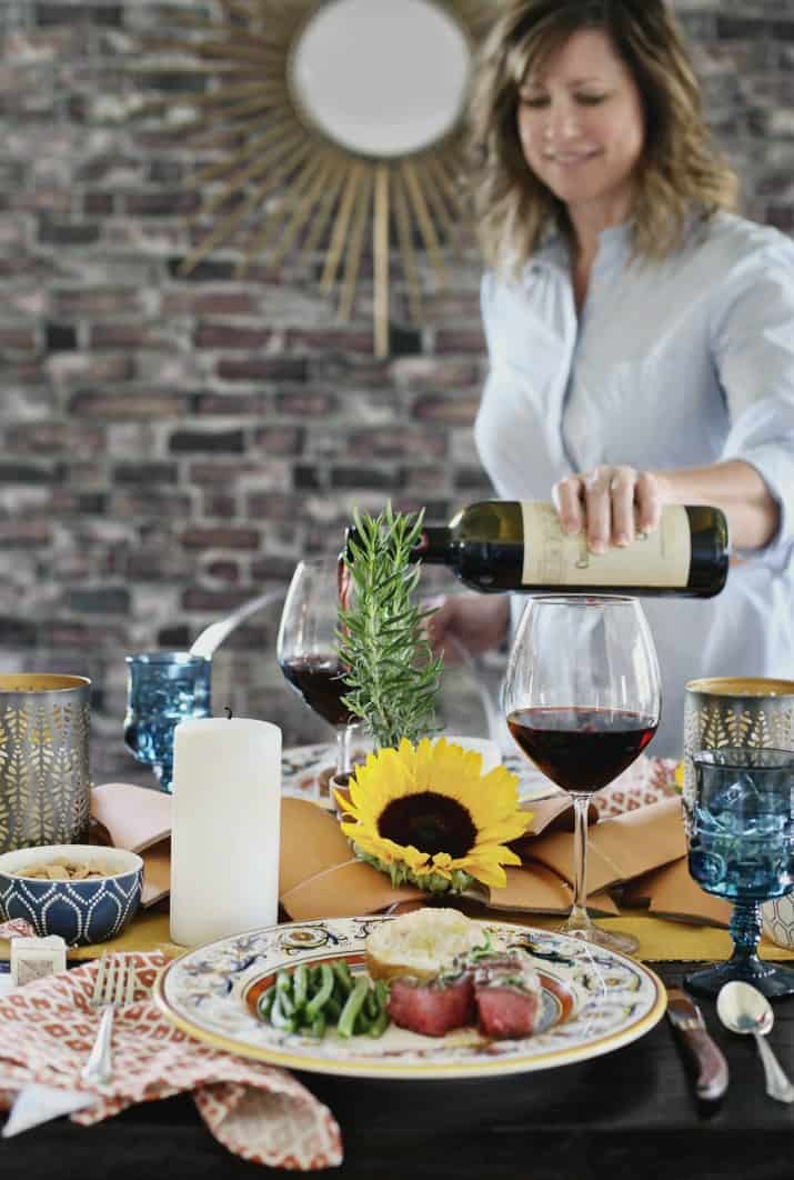 Italian themed dinner party & wine pairing, hostess pouring wine