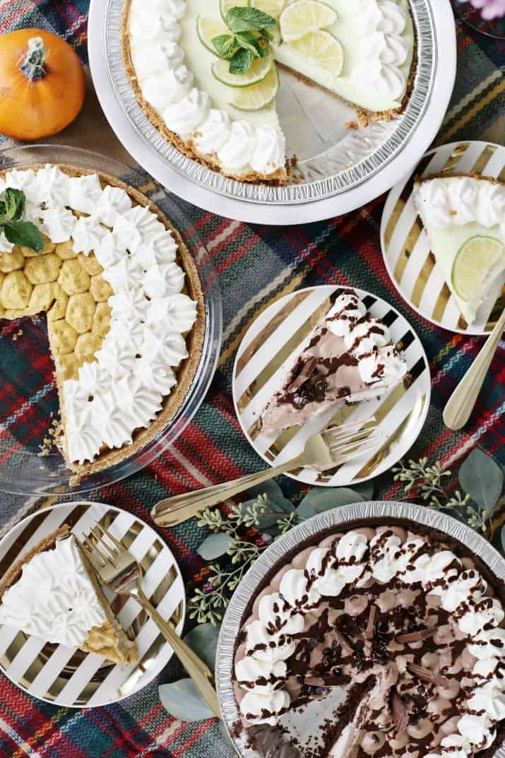 Stylish Pie Bar for Holiday Entertaining, pies and slices on plates top view