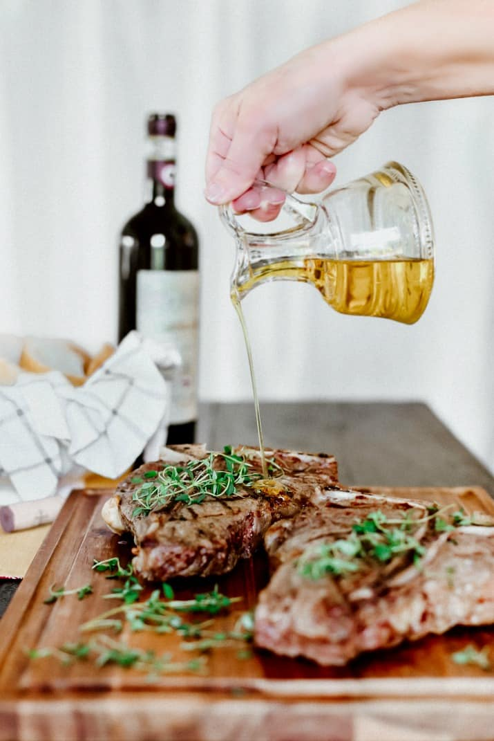 drizzle olive oil on steaks
