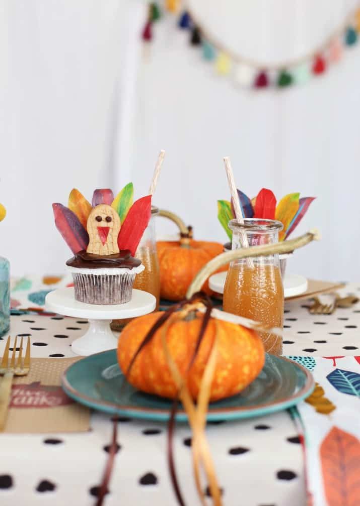 Thanksgiving kids table place setting with turkey cupcake