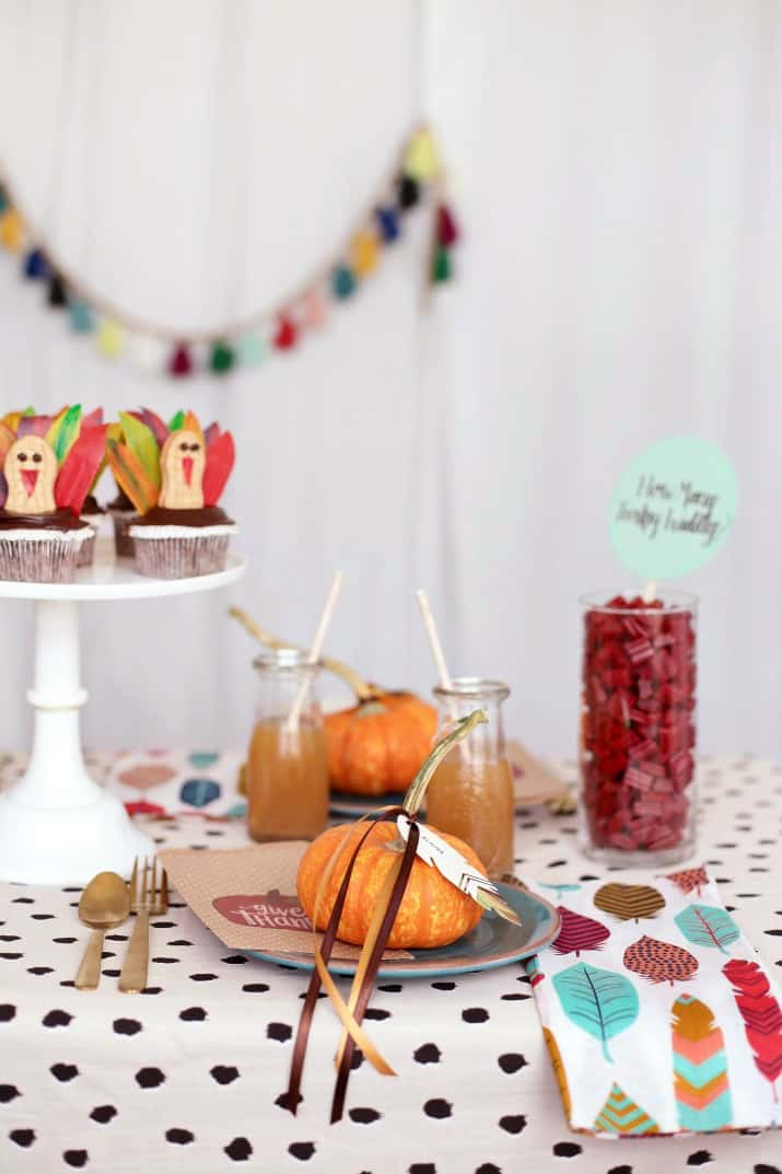 Thanksgiving kids table place setting with mini pumpkins